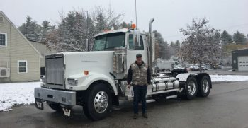 customer next to newly purchased western star truck