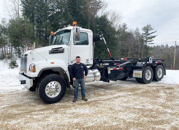 Chris standing in front of white truck